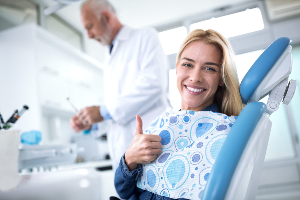 Woman smiling after painless Dental Visit